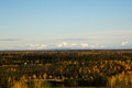 The alaska mountain range rises above the fields and forests surrounding fairbanks in autumn Stock Photography
