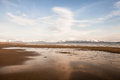Alaskan sandy beach empty near the kachemak bay with blue sky and clouds Stock Photo