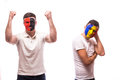 Albania vs romania on white background football fans of national teams demonstrate emotions – win – lose Stock Photos