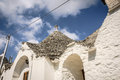 Alberobello trullo street with typical with blue sky and clouds Stock Image
