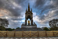 Albert memorial london the landmark in hyde park contrasting the neo gothic monument against a threatening sky the was built by Stock Image