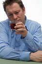 Alcohol abuse a depressed man with Stock Photography