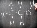 Alcohol chemical formula writing on blackboard Stock Photos