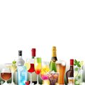 Alcohol cocktails and bottles over white background vector Royalty Free Stock Images