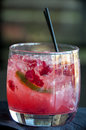 Alcohol drink this is a with cherries and lime with two straws this is a vodka sprite and grenadine Stock Photos