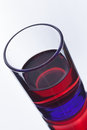 Alcohol drink red colorfull in blue glass on white background Stock Images