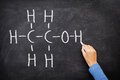 Alcohol ethanol on blackboard in chemistry class chemical molecule structure chalkboard science teacher or Stock Image