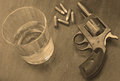 Alcohol and gun or firearm bullets booze a for a deadly combination in sepia Stock Photography