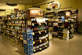 Alcohol liquor store a huge collection of alcohols wines brandy and other drinks in a supermarket Stock Image