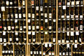 Alcohol liquor store lots of organized neatly on shelves in a big supermarket Royalty Free Stock Photo