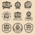 Alcohol logos. Wooden barrels set with drinks signs of cognac,brandy,whiskey,wine,beer. Labels with hand sketched kegs.