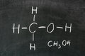Alcohol methanol on blackboard in chemistry class Royalty Free Stock Photography