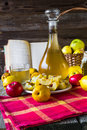 Alcohol quince liqueur sliced fruit prepare wooden setting tincture of and on a table Stock Photography