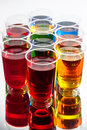 Alcohol shots with reflection multi coloured Royalty Free Stock Images