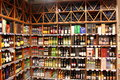 Alcohol store a big with huge collection of alcohols wines or other drinks wine rack in the supermarket Stock Photos