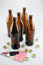 On alcohol tax license and many beer bottles Royalty Free Stock Photos