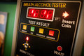 Alcohol tester on a wall Royalty Free Stock Photo