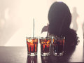Alcohol three glasses of on a table Royalty Free Stock Images