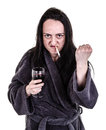 Alcoholic aggressive woman shaking fist while drinking red wine and smoking Stock Images
