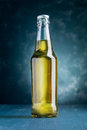 Alcoholic beverage bottle on blue background Royalty Free Stock Image