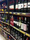 Alcoholic beverages bottles of exposed on the market shelves Royalty Free Stock Photo