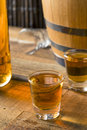 Alcoholic Brown Rum in a Shot Glass Royalty Free Stock Photo