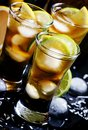 Alcoholic cocktail coconut cola, liqueur, lime, lemon and ice, b Royalty Free Stock Photo