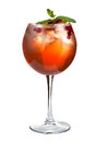 Alcoholic cocktail with cranberries and ice. Strong alcoholic drink on a white background