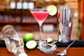 Alcoholic cocktail drink with vodka and triple sec on counter Royalty Free Stock Photo
