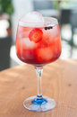 Alcoholic drinks with ice and strawberry Stock Photos
