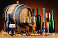 Alcoholic drinks still life with different and wooden barrel Royalty Free Stock Image