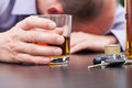 Alcoholic sleeping on the table with car keys Stock Photo