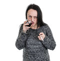 Alcoholic woman drinking red wine from glass and smoking Stock Image