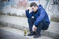 Alcoholism man street alcohol and on the Stock Photos