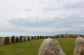Ale stones near kaseberga in sweden or ales stenar are situated the hills above kåseberga just east of ystad some believe that Royalty Free Stock Photo