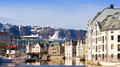 Alesund water view norway colorful buildings along the waterway known as alesundet with a cruise ship in the background in the Stock Image