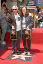 Alex lifeson geddy lee and at the induction ceremony for rush into the hollywood walk of fame hollywood ca Stock Photo