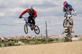 Alexandro kim followed by carlos castelo branco portugal may rosado at the rd stage of the luso spanish bmx race trophy the on may Stock Photography
