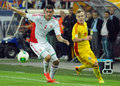 Alexandru maxim and richard guzmics in romania hungary s s pictured action during the fifa world cup qualifier game between Stock Photo