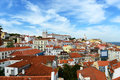 Alfama district at the east of lisbon portugal with monastery sao vicente de fora and dome santa engracia background in Stock Images