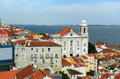 Alfama district at the east of lisbon portugal small church in with tagus river background Royalty Free Stock Photo