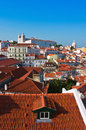 Alfama district in lisbon with monastery of sao vicente de fora sunny summer afternoon on the top the hill Stock Photos