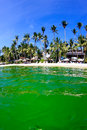 Algae bloom in the ocean a bright green near a tropical island rising sea temperatures global warming and pollution are making Stock Photography