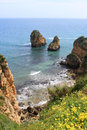 Algarve cliffs rocky on the coast of the atlantic ocean in lagos portugal Royalty Free Stock Image