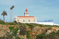 Algarve lighthouse in lagos on the rocky cliffs of the coast the atlantic ocean ponte da piedade portugal Stock Photos