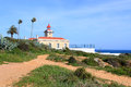 Algarve lighthouse in lagos on the rocky cliffs of the coast the atlantic ocean ponte da piedade portugal Royalty Free Stock Photos