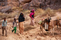 Algerian nomads group of tuareg on their way to gather water from a nearby lake in tassili n ajjer algeria Royalty Free Stock Images