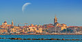 Alghero at sunset under the moon a huge Royalty Free Stock Image