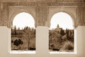 Alhambra arches in sepia of generalife palace with garden view granada Stock Photos
