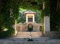 Alhambra gardens - architecture & lush vegetation Royalty Free Stock Photo